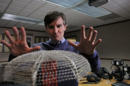 Examining a model of one of the devices that LEC of Boulder, CO, uses to protect locations from lightning.