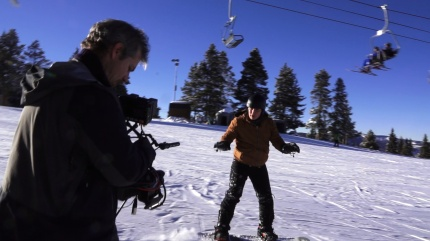 "Snowboarding for the ""Hacking The Planet"" cameras in Vail, CO, as I speak about snowmaking."