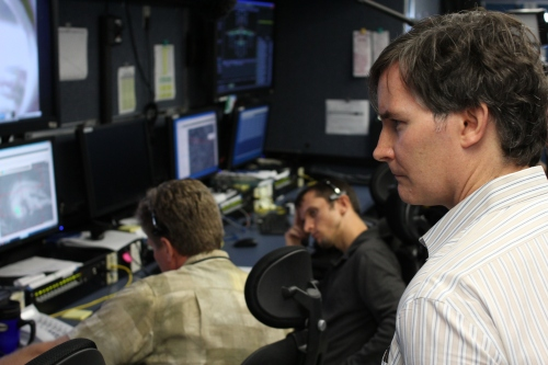 """At NASA's Wallops Island flight facility, inside the """"science trailer"""" that processes data beaming back from a Global Hawk drone flying over tropical storm Nadine."""