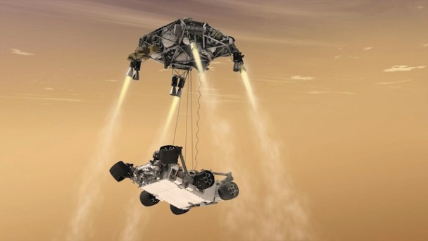 Descent stage of the Mars Science Laboratory vehicle, lowering the folded Curiosity rover in the sky crane maneuver. (Credit: NASA/JPL-Caltech)